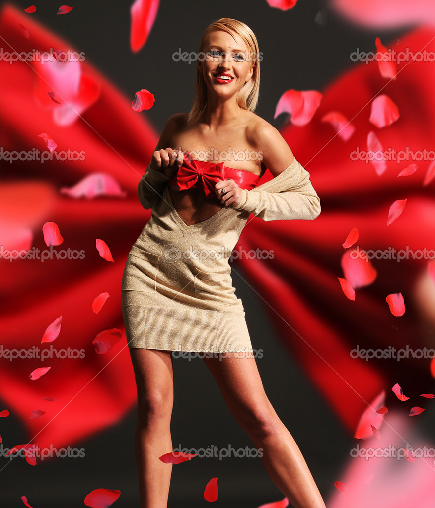 Beautiful woman wearing red ribbon — Stock Photo #5191157