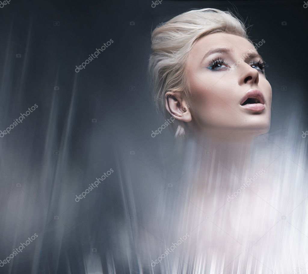 Modern style portrait of a young blonde beauty  Stock Photo #5191259