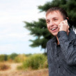 Royalty-Free Stock Photo: Smiling guy talking on cellphone