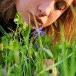 Stock Photo: Girl bent over to flower