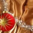 Thread tinsel on golden background — 图库照片