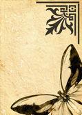 Schmetterling auf alte pergament — Stockfoto