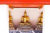 Ancient golden Buddha statue — Stock Photo