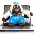 Monkey with a laptop — Stock Photo