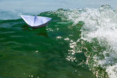 Paper boat struggling with a huge foamy waves — Stock Photo