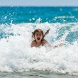 Little girl at sea in sunny day - Stock Photo
