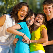 A group of young having fun in the park - Stock Photo