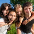 Four young having fun in the park — Stock Photo #3494789