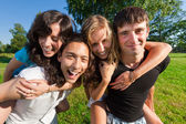 Four young having fun in the park — Stock Photo