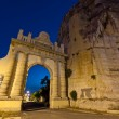Naples gate on the Appian Way in the Italian town of Terracina - Stock Photo