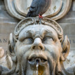 Pigeon sitting on a sculpture - Stock Photo