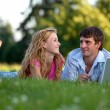Stock Photo: A couple relaxing in the park with a laptop
