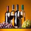 Stock Photo: Bottles, glasses and grapes