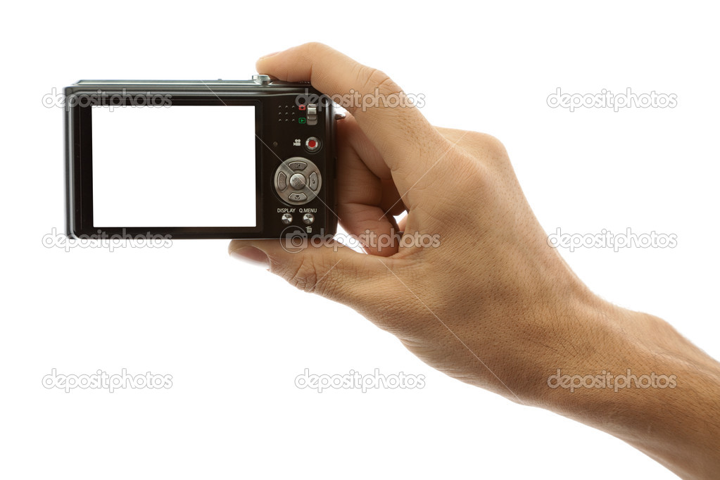 Hand of a man holding a digital camera on a white background — Stock Photo #3864038