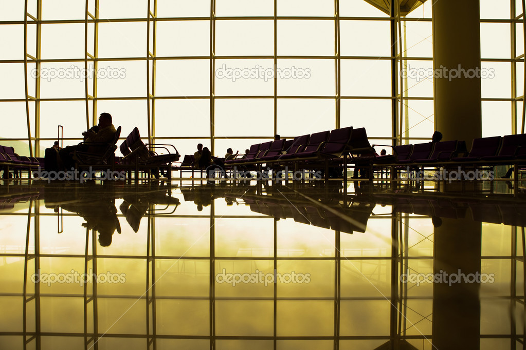 Passengers waiting for their flights in the departure lounge. — Stock Photo #3230365