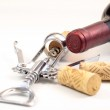 Corks, red wine and corkscrew — Stock Photo