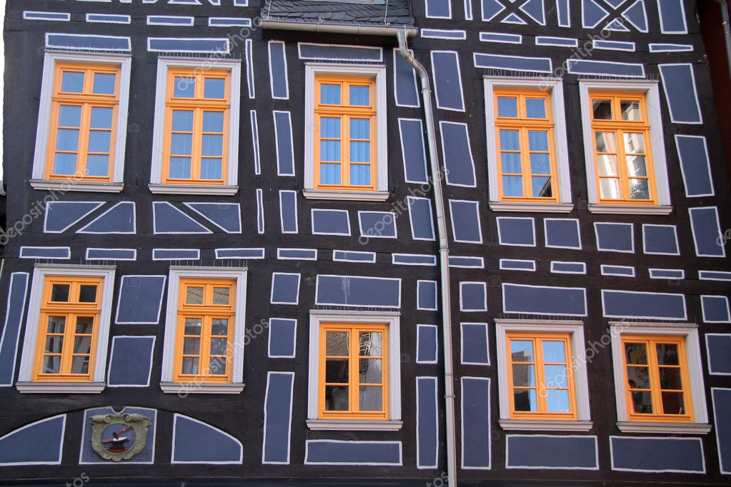 Half-timbered house with yellow windows in Hesse, Germany — Stock Photo #3346019