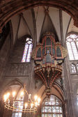 Candleholder and organ of Strasbourg cathedral — Stock Photo