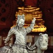 Stock Photo: Buddhist temple keeper statue