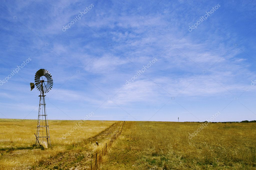 Windmill on a lucerne farm with a blue sky — Stock Photo #3302889
