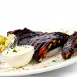 Pork ribs with a baked potato and sour cream - Stock Photo