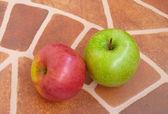 Apples over floor — Stock Photo