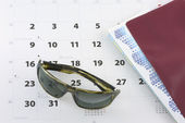 Sunglasses, tickets and calendar — Stock Photo