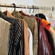 Clothes on hangers — Stock Photo #3310720