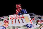 Cards with gambling chips and money — Stock Photo