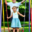 Boy and girl on swing — Stock Photo #3547054