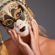 Beautiful young woman wearing carnival mask — Stock Photo