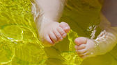 Baby's feet in water — Stock Photo