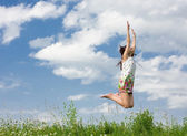 Young woman is jumping — Stock Photo