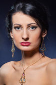 Beautiful woman wearing jewelry. — Stock Photo