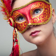 Attractive beautiful young woman wearing red carnival mask — Stock Photo