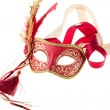 Red and gold feathered carnival mask - Stock Photo