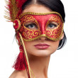Stock Photo: Young womwearing red carnival mask