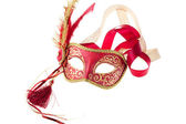Red and gold feathered carnival mask — Stock Photo