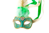 Green and gold feathered carnival mask — Stock Photo