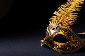 Schwarz und gold Maske — Stockfoto