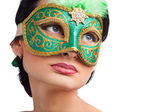 Beautiful woman wearing green carnival mask — Stock Photo