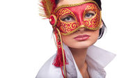 Young woman wearing red carnival mask — Stock Photo
