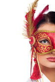 Beautiful young woman wearing red carnival mask — Stock Photo
