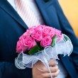 Royalty-Free Stock Photo: Groom hold wedding bouquet