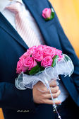 Groom hold wedding bouquet — Stock Photo