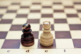 Wedding rings on chess figures — Stock Photo
