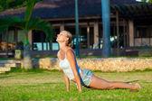 Young woman doing yoga exercise — Stock Photo