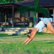 Young woman doing yoga exercise outdoors — Stock fotografie