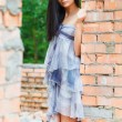 Girl near old wall — Stock Photo