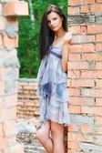 Girl near old wall — Стоковое фото
